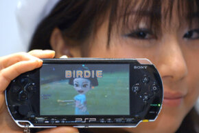 A model shows a PlayStation Portable (PSP) manufactured by Sony Computer Entertainment, Sony Corp.'s video-game unit.