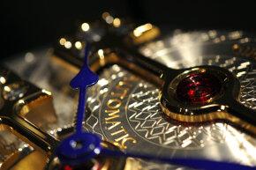 A Girard-Perregaux watch movement sits on display at the Salon International de la Haute Horlogerie (SIHH) watch fair in Geneva, Switzerland.