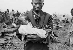 A father cradles his sick child during the cholera outbreak in 1994 that claimed thousands of lives in Goma, Zaire. Cholera is a diarrhea-causing illness contracted by consuming water or food contaminated with V. cholerae bacteria.