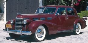 Considered a landmark automotive design, the 1938 Cadillac Sixty Special sported chrome-edged windows and squareback fenders.