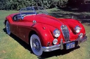 """Wide stripe"" grille, chrome hood strip, and heftier bumpers were the main outward changes on the XK-140 of 1954-1957."