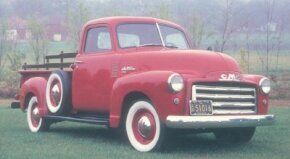 Although GMC pickups were growing ever closer in design to their Chevrolet siblings, the chrome grille of this 1950 GMC FC101 pickup was unique to GMC. See more classic truck pictures.