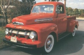 "The 1951 Ford pickup sported a new grille with a ""toothy"" single-bar design. The look would carry on with minor revisions through 1956. See more classic truck pictures."