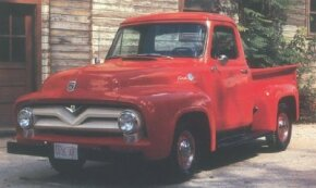 The 1955 Ford F-100 pickup is distinguished by the V-shaped dip in the upper grille bar. Note the V-8 insignia; six-cylinder versions got a five-point star. See more classic truck pictures.