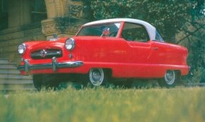 This Canyon Red coupe shows off the indent below the side windows.