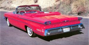 The 1960 Oldsmobile small Super 88 was vastly cleaner than the chrome-riddled 1958.