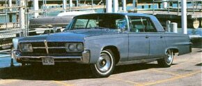 The 1965 Imperial gained a one-piece grille with covers over the headlights.