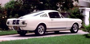 The Shelby GT-350 started as a white Mustang 2+2 fastback to which high-performance suspension, brake, and engine modifications were made.