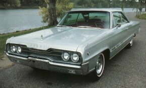"For 1966, the ""barbell"" effect of the Monaco 500's grille became more pronounced, and a forceful speedline thrust forward from the front wheel openings. Round ""500"" medallions and the three faux vents on the bodysides were Monaco 500 traits."