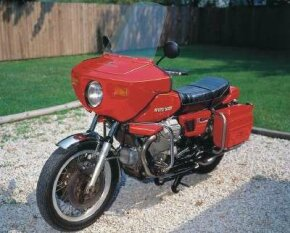 The 1976 Moto Guzzi V1000 Convert was distinguished by a torque converter that imparted some of the convenience of an automatic transmission. See more motorcycle pictures.