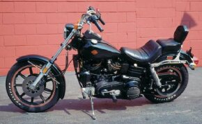 """A two-inch extension of the front forks gives the FXB Sturgis a """"chopper"""" look."""