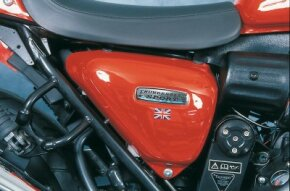 No mistaking this bike's nationality: Side covers wear a badge along with the British Union Jack.