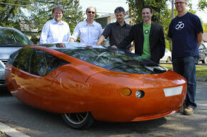 Members of the Urbee 2 design team pose with the Urbee 2, a 3-D printed car.