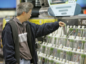 A man browses a large selection of video games.