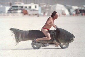 A Catmobile can't be far behind this fleeing trout bike at the Burning Man festival.