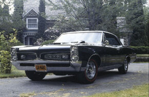 © The 1967 Pontiac GTO, with its distinctive grille, is one of the most imposing muscle cars ever built. See more muscle car pictures.