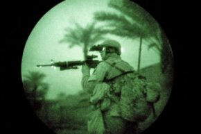 A U.S. Marine uses night vision goggles while on a search operation in the early hours in Iraq's Anbar province.