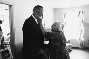 An elderly woman thanks President Lyndon B. Johnson for his signing of the Medicare health care bill in April 1965.