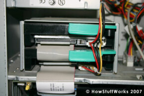 This cage contains two hard drives. If the computer's user wanted an additional hard drive, he would have to add an external one.