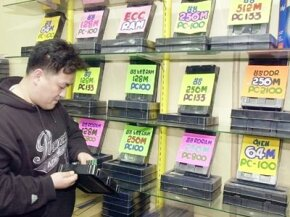 A microchip show owner in Seoul's electronics shopping mall checks the display of dynamic random access memory (DRAM) chips. Adding more RAM will make your programs run smoother, but up to a point any additional RAM has no effect.