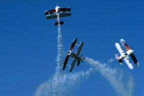 Old-fashioned planes are often still used in aerobatics shows.