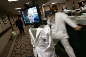 A doctor at Hackensack University Medical Center navigates the InTouch Health's RP-6 for Remote Presence robot, known as Mr. Rounder, while roaming the hallway in 2005.