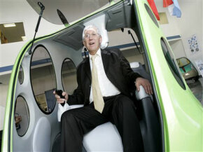 MDI's Guy Negre shows off the AirPod One prototype in January 2009.