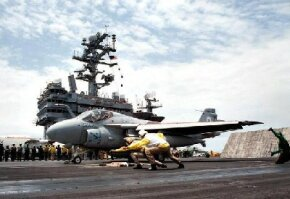 An A-6E Intruder launches from the USS George Washington.