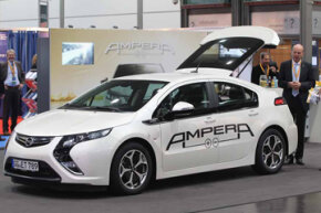 Visitors look at the Opel Ampera gasoline and electric car in Leipzig, Germany. In the USA the car is sold under the brand Chevy Volt. Want to learn more? Check out these electric car pictures!
