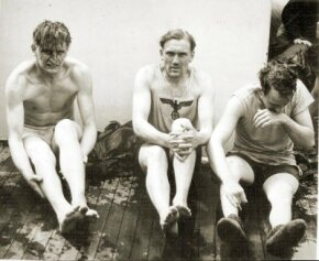 A German U-boat crew become POWs after their submarine was depth-charged in the Atlantic. In July 1943, the German navy withdrew from the Atlantic battle.