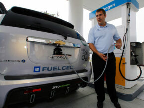 Alex Keros, a General Motors senior engineer, demonstrates how to fill up a General Motors Chevrolet Equinox fuel cell-electric SUV with hydrogen at California's first hydrogen refueling station.