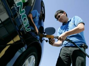 A man fuels up his natural gas vehicle at a Clean Energy station in San Francisco, Calif.