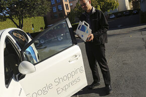 A Google Express courier picks up an order to deliver to a customer.