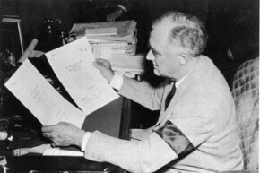 President Franklin D. Roosevelt holds the Declaration of War against Japan after the bombing of Pearl Harbor, circa 1941.