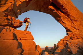 A hiker stands in Arches National Park in Moab, Utah. Heck, a view that breathtaking could inspire anyone to join a hiking society.