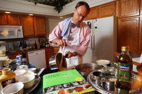"Author and host of ""America's Test Kitchen,"" Chris Kimball, serving up corn soup in 2004."