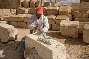 A modern stonemason continues preservation efforts on the 2,000-year-old Roman city of Jerash, Jordan, using some techniques that a stonemason from that time period might have recognized.