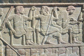 An Etruscan 5th century stone tablet shows two judges with a scribe (at right).