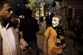 An Egyptian protester wearing a Guy Fawkes near Tahrir Square on Jan. 28, 2013.