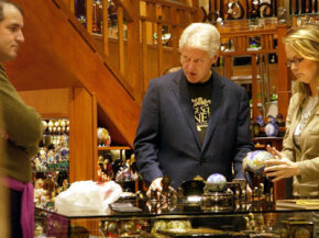 Former U.S. President Bill Clinton adds to his collection in an antique shop in downtown Prague 11 November 2005.
