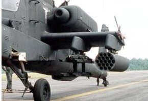 The Hydra rocket launcher (right) and Hellfire missile rails (left) on an AH-64A Apache helicopter