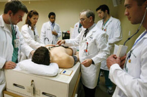 Medical students at the University of Miami work with Harvey, the cardiopulmonary patient simulator.