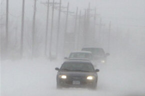 Vehicles travel in poor visibility near Mead, Neb.