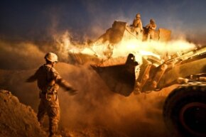 Combat engineers from the Marines tear down patrol bases throughout Helmand province in Afghanistan in December 2011, paving the way for Afghan pullout by U.S. troops.