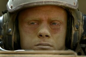 A dusty U.S. Army combat engineer after a ride in his armored vehicle through the Iraqi desert on March 31, 2003. At that point in the Iraq War, engineers like him mostly were tasked with clearing the way so U.S. troops could advance.