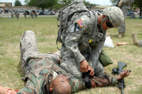 Army combat medics have to be prepared to administer to patients on the battlefield. Here, a medic practices applying a tourniquet to a soldier at Fort Hood in Texas.