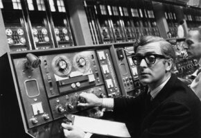 """Actor Michael Caine plays the cockney spy Harry Palmer in the 1967 movie """"Billion Dollar Brain."""" A Honeywell computer, like one that the UCLA team used to connect to ARPANET, is the basis of a huge film set at Pinewood Studios."""