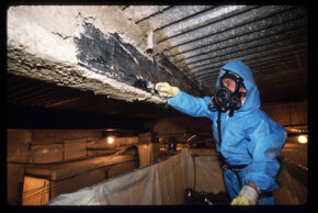 Numerous asbestos abatement firms have been established to remove asbestos, as seen in this 1988 photo.