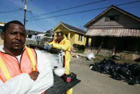 As if Hurricane Katrina didn't cause enough problems, the storm also disturbed asbestos present in older homes. Specially trained crews, like the one of which Anthony Neal (above) is a member, were called in to help deal with asbestos removal. See more pictures of natural disasters.