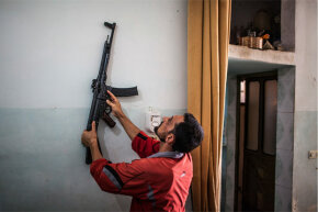 August 2012: A Sturmgewehr 44 hangs on the wall of a home in Tal Rifaat, Syria. According to some reports, Syrian rebels found thousands of the World War II-era weapons in a large warehouse.
